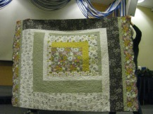 One Large Log Cabin Block by Sharon Hickok